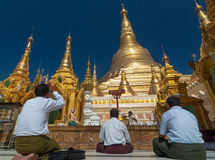 Buddhist pray at the Shwedagon Pagoda Royalty Free Stock Photo