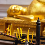Buddhist prayer candles Stock Images