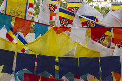 Buddhist prayer flags at the Bodi Tree complex, Sri Lanka. Strings of Buddhist prayer flags hung at the Bodi Tree temple complex in Sri Lanka. The prayer flags Stock Images
