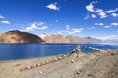 Buddhist prayer flags flying at Pangong Lake, Ladakh, India Royalty Free Stock Images