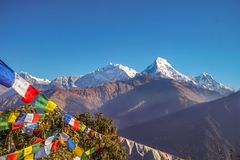 Buddhist Prayer Flags Hanging along Hiking Paths in Nepal. Trekking in the Himalayas