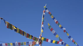 Buddhist prayer flags the holy traditional flag in Leh. Stock Photo