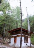 Buddhist prayer flags & house Royalty Free Stock Photo