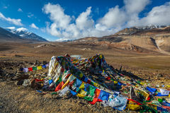Buddhist prayer flags (lungta) on Baralacha La pass in Himalayas Stock Image