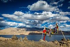 Buddhist prayer flags lungta at Himalayan lake Stock Image