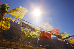 Buddhist prayer flags on a sky background in Himalayas Stock Photos