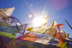 Buddhist prayer flags on a sky background in Himalayas Stock Images