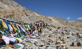 Buddhist prayer flags and stone pyramids Stock Photography
