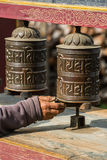 Buddhist prayer mani wall with prayer wheels in nepalese village Stock Images