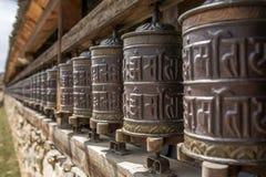 Buddhist prayer mani wall with prayer wheels in nepalese village Stock Photo