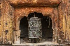 Buddhist prayer mani wall with prayer wheels in nepalese village Stock Photos