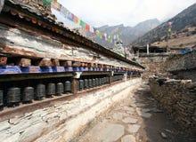 Buddhist prayer many wall with prayer wheels Stock Photos
