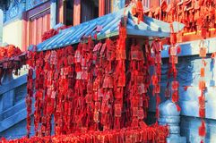 Buddhist Prayer request plaques xiangshan temple. Red prayer requests hanging within the Xiangshan Temple property in Longmen Grottoes scenic area Luoyang China royalty free stock image