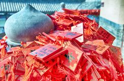 Buddhist Prayer request plaques xiangshan temple. Red prayer requests hanging from a railing within the Xiangshan Temple property in Longmen Grottoes scenic area stock image