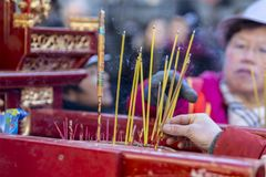 Buddhist Prayer Sticks Burning - Chinese New Year Parade, Paris. Paris, France-February 25,2018: Detail of Buddhist prayer sticks burning on a mobile shrine Stock Images