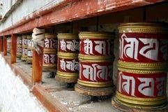 Buddhist prayer wheels. Ladakh, Little Tibet (India) - Colorful Buddhist prayer wheels in a row Stock Photos
