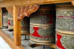 Buddhist prayer wheels. Ladakh, Little Tibet (India) - Colorful Buddhist prayer wheels in a row Stock Photo
