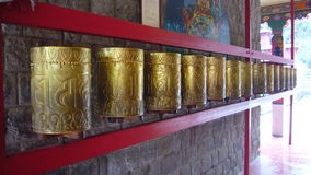 Buddhist prayer wheels. Prayer wheels in a Buddhist temple in Tibet Stock Photo