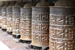 Buddhist prayer wheels. Buddha statue at Swyambhunath, Kathmandu,Nepal stock photography