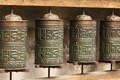 Buddhist prayer wheels. Detail photos rotate prayer mills stock images