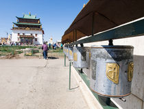 Buddhist prayer wheels and Gandan Royalty Free Stock Photo
