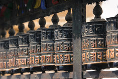 Buddhist prayer wheels, Kathmandu, Nepal. Royalty Free Stock Image