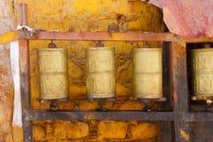 Buddhist prayer wheels in Lhasa, Tibet. Buddhist prayer wheels, one spinning, in Lhasa, Tibet Royalty Free Stock Photos