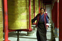 Buddhist Prayer Wheels. The old women was revolving the buddhist prayer wheels which located in the western Sichuang Province in China royalty free stock images