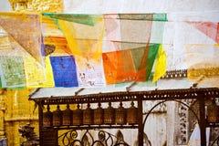Buddhist prayer wheels and prayer flags Stock Photos