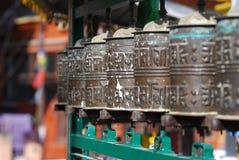 Buddhist prayer wheels in a row Stock Image
