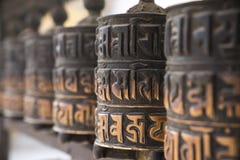 Buddhist prayer wheels in row Royalty Free Stock Photo
