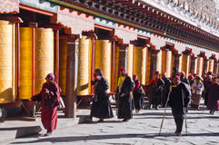 Buddhist Prayer Wheels in a Row Stock Photo