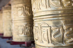 Buddhist prayer wheels Stock Images