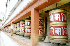 Buddhist Prayer wheels at the temple in Ladakh, India Stock Image