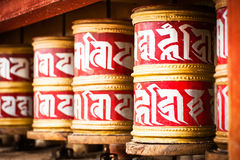 Buddhist prayer wheels in Tibetan monastery Royalty Free Stock Photo