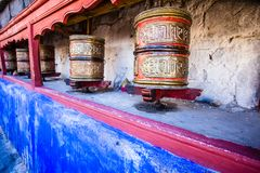 Buddhist prayer wheels in Tibetan monastery with written mantra. India, Himalaya, Ladakh Stock Photo