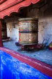 Buddhist prayer wheels in Tibetan monastery with written mantra. India, Himalaya, Ladakh Stock Photography