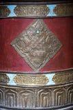 Buddhist prayer wheels in Tibetan monastery with written mantra. India Stock Photos