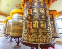 Buddhist prayer wheels. In Tibetan monastery with written mantra, Yoksom, Sikkim, India Royalty Free Stock Photos