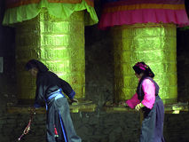 Buddhist Prayer Wheels. The two old woman was revolving the buddhist prayer wheels which located in the western Sichuang Province in China stock photos