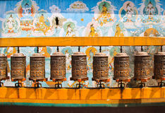 Buddhist prayer wheels with wall, Nepal Stock Image