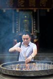Buddhist prayers burning incense. In a temple in Sichuan, China royalty free stock photography