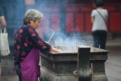 Buddhist prayers burning incense. In a temple in Sichuan, China royalty free stock images