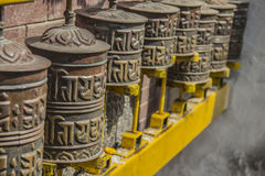 Buddhist prayers in Kathmandu, Nepal. Rotating cylinders with Buddhist prayers in Boudhanath Temple, Kathmandu, Nepal Royalty Free Stock Photo