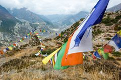 Buddhist praying flags blowing in the wind. Royalty Free Stock Photography