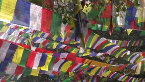 Buddhist praying flags in  Buddha birthplace in Lumbini, Nepal Stock Photo