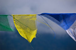 Buddhist praying flags floating in the wind Stock Photography