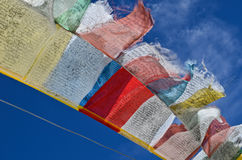 Buddhist praying flags floating in the wind Stock Images