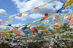 Buddhist praying flags floating in the wind Stock Image