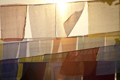 Buddhist praying flags at the sunset Stock Photography